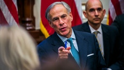 AUSTIN, TX - MAY 24: Texas Governor Greg Abbott holds a roundtable discussion with victims, family, and friends affected by the Santa Fe, Texas school shooting at the state capital on May 24, 2018 in Austin, Texas. Representatives from Sutherland Springs, Alpine, and Killeen were also invited and address the governor.
