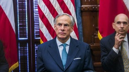 AUSTIN, TX - MAY 24: Texas Governor Greg Abbott (C) holds a roundtable discussion with victims, family, and friends affected by the Santa Fe, Texas school shooting at the state capital on May 24, 2018 in Austin, Texas. Representatives from Sutherland Springs, Alpine, and Killeen were also invited and address the governor.