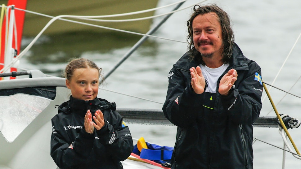 "Swedish climate activist Greta Thunberg, 16, and father Svante Thunberg arrive in the US after a 15-day journey crossing the Atlantic in the Malizia II, a zero-carbon yacht, on August 28, 2019 in New York. - ""Land!! The lights of Long Island and New York City ahead,"" she tweeted early Wednesday. She later wrote on Twitter that her yacht had anchored off the entertainment district of Coney Island in Brooklyn to clear customs and immigration."