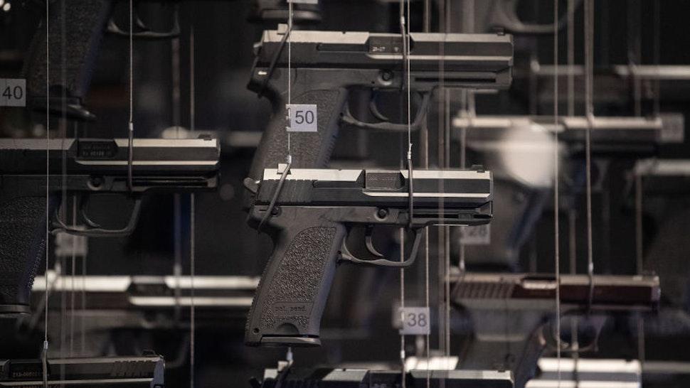 18 December 2019, Baden-Wuerttemberg, Oberndorf am Neckar: Pistols hang in a showcase in the museum of the weapons manufacturer Heckler & Koch. Photo: Marijan Murat/dpa (Photo by Marijan Murat/picture alliance via Getty Images)