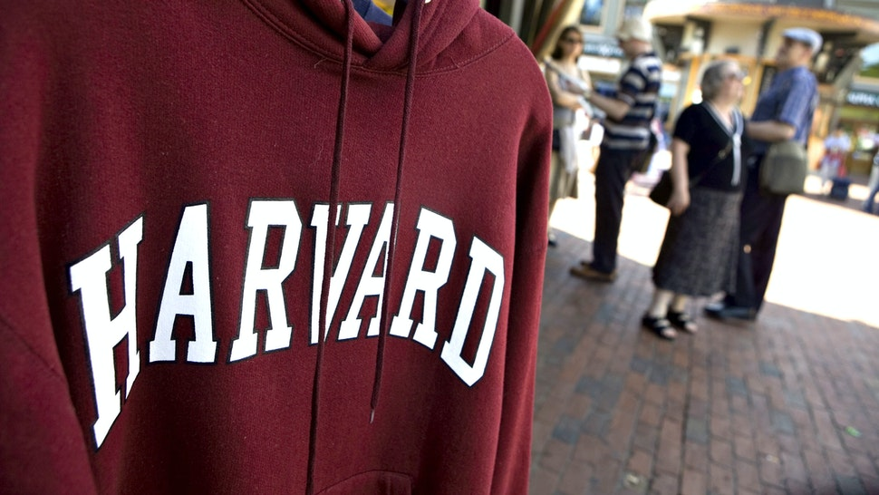 UNITED STATES - SEPTEMBER 03: A Harvard University logo appears on a sweatshirt on display in Harvard Square in Cambridge, Massachusetts, U.S., on Friday, Sept. 4, 2009.