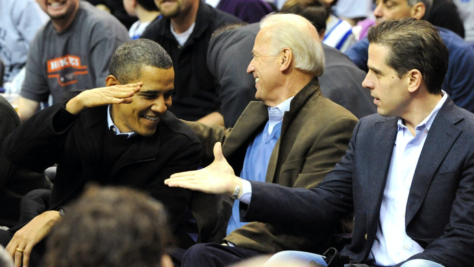 WASHINGTON - JANUARY 30: (AFP OUT) U.S. President Barack Obama (L) greets Vice President Joe Biden (C) and his son Hunter Biden as they attend the game between the Duke Blue Devils and Georgetown Hoyas on January 30, 2010 at the Verizon Center in Washington, DC.