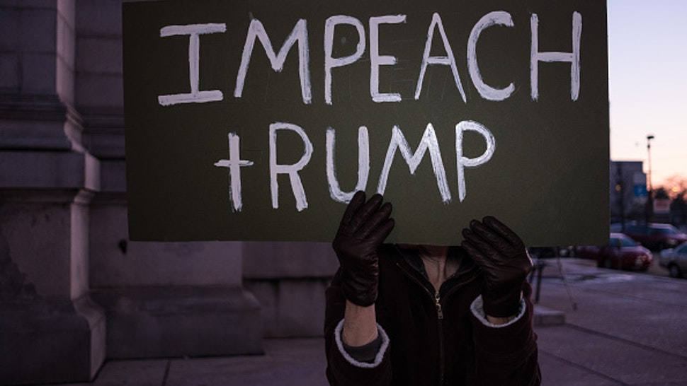 DAYTON, OHIO, UNITED STATES - 2019/12/17: A protester holds an Impeach Trump placard during a Trump pro-impeachment rally in Dayton. The protesters gathered in Dayton to show their support for Trumps impeachment the day before the House vote.