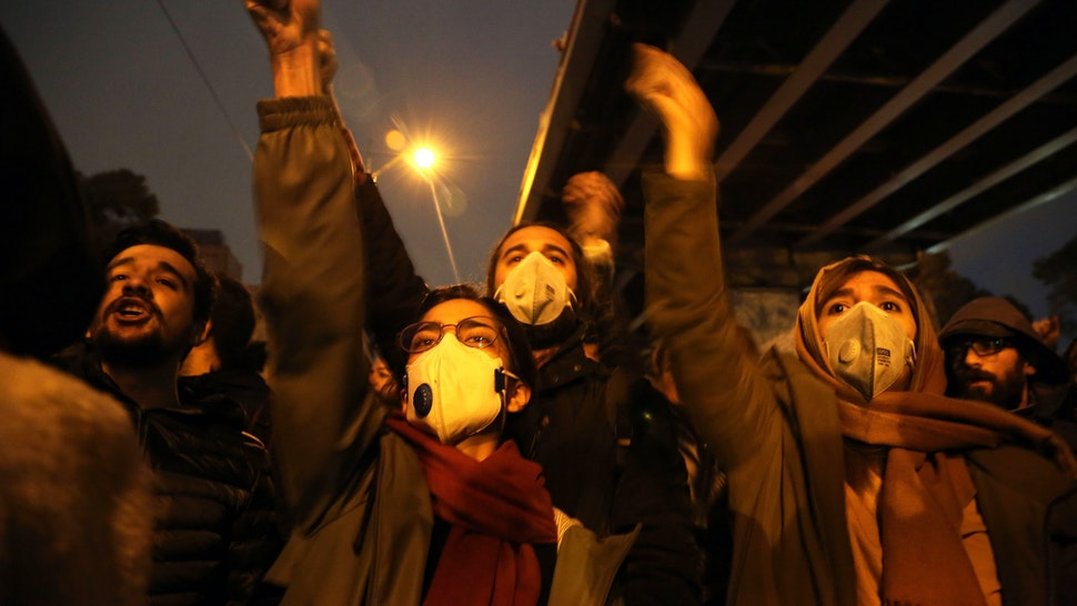 TEHRAN, IRAN - JANUARY 11 : Iranians shout slogans against the government after a vigil held for the victims of the airplane of Ukrainian International Airlines that crashed near Imam Khomeini Airport turned into an anti-government protest outside Amirkabir University in Tehran, Iran on January 11, 2020.