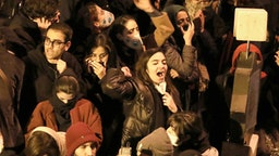 """Iranians students chant slogans as they demonstrate following a tribute for the victims of Ukraine International Airlines Boeing 737 in front of the Amirkabir University in the capital Tehran, on January 11, 2020. - Iranian police dispersed students chanting """"radical"""" slogans during a gathering in Tehran to honour the 176 people killed when an airliner was mistakenly shot down, Fars news agency reported. AFP correspondents said hundreds of students had gathered early in the evening at Amir Kabir University, in downtown Tehran, to pay respects to those killed in the air disaster."""