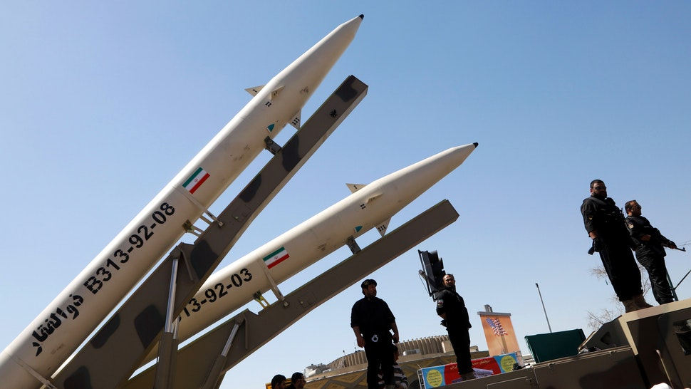 """Zolfaghar missiles (R) are displayed during a rally marking al-Quds (Jerusalem) Day in Tehran on June 23, 2017. Chants against the Saudi royal family and the Islamic State group mingled with the traditional cries of """"Death to Israel"""" and """"Death to America"""" at Jerusalem Day rallies across Iran today."""