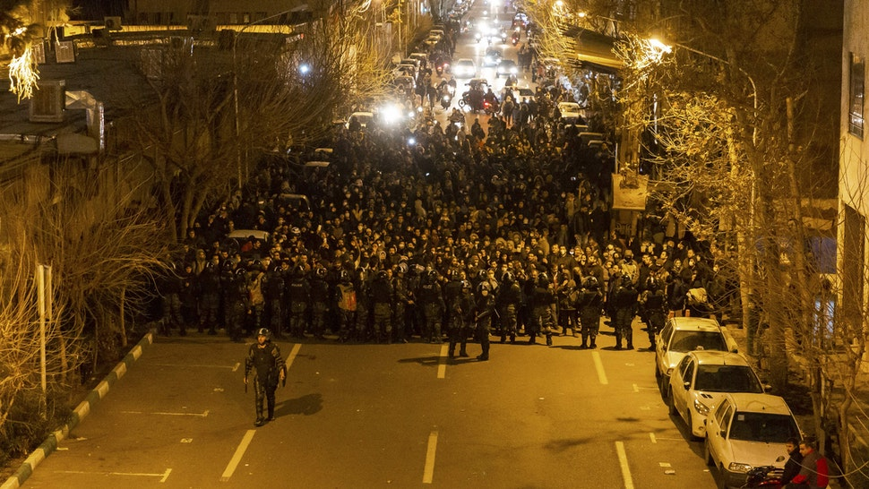Iranian riot police stand guard as protesters gather in front of Tehran's Amir Kabir University on January 11, 2020. - Demonstrations broke out for a second night in a row after Iran admitted to having shot down a Ukrainian passenger jet by mistake on January 8, killing all 176 people on board.