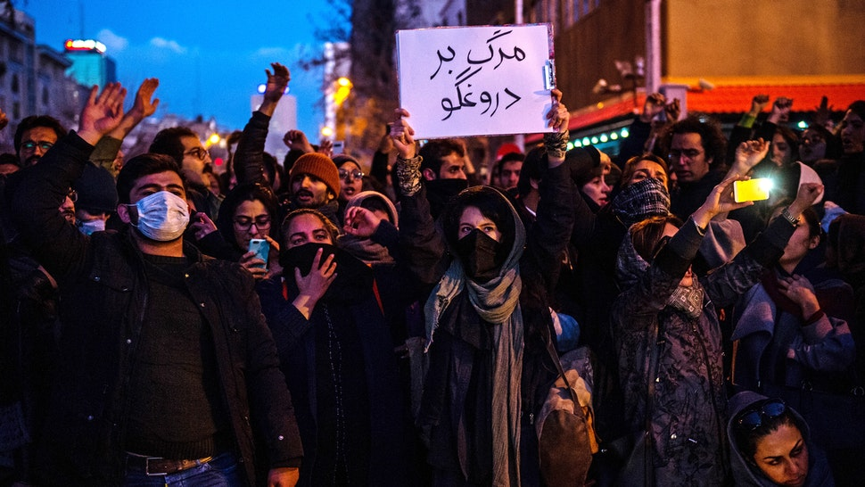 Demonstrators chant while gathering during a vigil for the victims of the Ukraine International Airlines flight that was unintentionally shot down by Iran, in Tehran, Iran, on Saturday, Jan. 11, 2019. Iran admitted it unintentionally shot down a Ukrainian jetliner that it mistook for a cruise missile, a dramatic reversal after days of denials that triggered international condemnation and protests in the streets of Tehran.