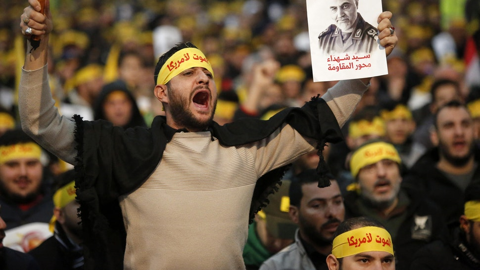 BEIRUT, Jan. 5, 2020 -- Supporters shout slogans during a rally for Qassem Soleimani in southern suburbs of Beirut, Lebanon, on Jan. 5, 2020. Hezbollah leader Sayyed Hassan Nasrallah urged on Sunday its fighters to attack U.S. soldiers in the region in retaliation for the assassination of Iranian top commander Qassem Soleimani by the United States.