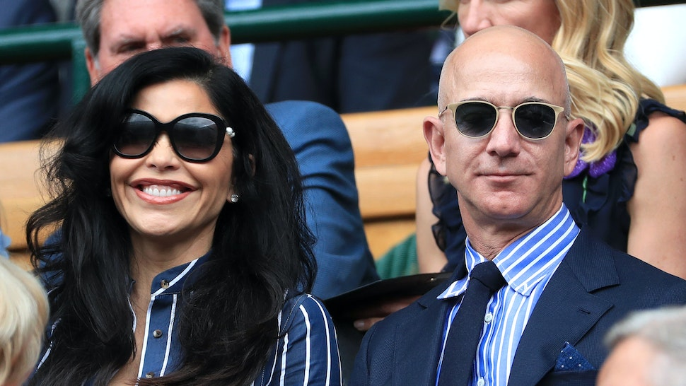 LONDON, ENGLAND - JULY 14: Jeff Bezos and his partner, Lauren Sanchez, look on from the Royal Box on Centre Court on Day 13 of The Championships - Wimbledon 2019 at the All England Lawn Tennis and Croquet Club on July 14, 2019 in London, England.