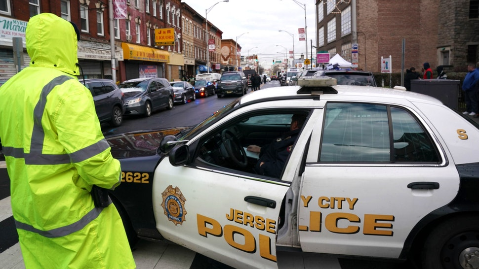 "Jersey City Police gather at the scene of the December 10, 2019 shooting at a Jewish Deli on December 11, 2019 in Jersey City, New Jersey. - The shooters who unleashed a deadly firefight in Jersey City deliberately targeted a kosher grocery, the city's mayor said December 11, 2019, suggesting that it was an anti-Semitic attack.""Last night after extensive review of our CCTV system it has now become clear from the cameras that these two individuals targeted the Kosher grocery,"" wrote Jersey City Mayor Steven Fulop on Twitter."