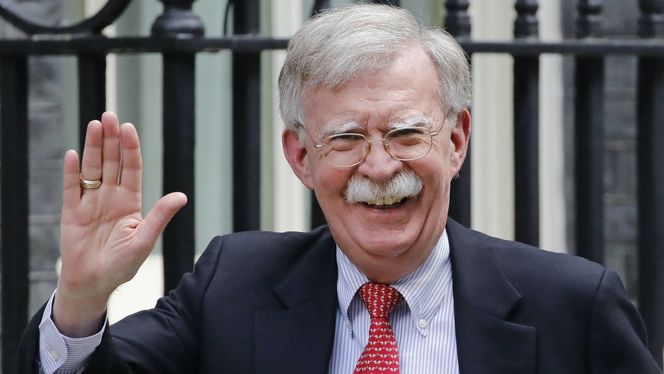 """US National Security Advisor John Bolton arrives in Downing Street in London on August 13, 2019, ahead of his meeting with Britain's Chancellor of the Exchequer Sajid Javid. - US National Security Advisor John Bolton said Monday that Washington wanted """"to move very quickly"""" on a trade deal with Britain after it leaves the EU, and that the White House would wait until after Brexit to address various security concerns."""
