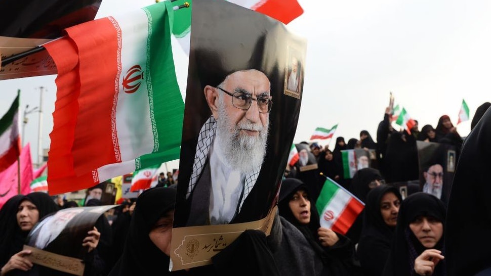 Demonstrators hold posters of Iranian Supreme Leader Ayatollah Ali Khamenei during a pro-government demonstration to react to protests due to fuel price increase of Iran, on November 25, 2019 in Tehran, Iran. (Photo by Fatemeh Bahrami/Anadolu Agency via Getty Images)
