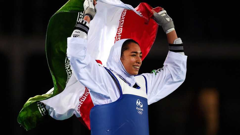 RIO DE JANEIRO, BRAZIL - AUGUST 18: Kimia Alizadeh Zenoorin of the Islamic Republic of Iran celebrates after defeating Nikita Glasnovic of Sweden during the Women's -57kg Bronze Medal Taekwondo contest at the Carioca Arena on Day 13 of the 2016 Rio Olympic Games on August 18, 2016 in Rio de Janeiro, Brazil.