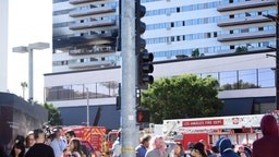 "People stand outside the building after a fire on January 29, 2020 in Los Angeles, California. - A fire suspected to have been started deliberately January 29, 2020 in a high-rise residential block in Los Angeles injured eight people, including a baby, and prompted a massive response by firefighters.Earlier reports had said several people had jumped from the 25-story Barrington Plaza in the west of the city but authorities later clarified that was not the case.""No one jumped, there are no fatalities,"" deputy fire chief Armando Hogan told reporters. ""Two people contemplated jumping but we told them to stay where they were."" (Photo by FREDERIC J. BROWN / AFP)"