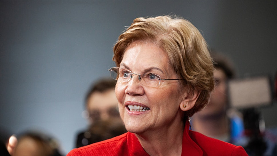 Senator Elizabeth Warren, a Democrat from Massachusetts and 2020 presidential candidate, speaks with a member of the media in the spin room following the Democratic presidential debate in Los Angeles, California, U.S., on Thursday, Dec. 19, 2019. Candidates take the stage for the sixth debate of the nomination race a day after House lawmakers voted along bitter partisan lines to impeach the man they want to beat in 2020, President Donald Trump.