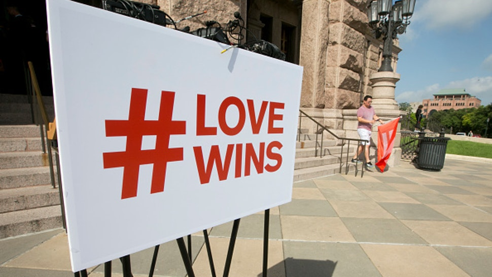 Love Wins sign on podium at the Texas Capitol before a press conference hosted by the Human Rights Campaign celebrating the recent SCOTUS ruling on marriage equality