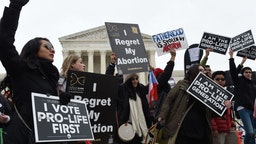 Pro-life activists demonstrate in front of the the US Supreme Court during the 47th annual March for Life on January 24, 2020 in Washington, DC. - Activists gathered in the nation's capital for the annual event to mark the anniversary of the Supreme Court Roe v. Wade ruling that legalized abortion in 1973.