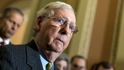 WASHINGTON, DC - JANUARY 14, 2020: Addressing journalists' questions, Senate Majority Leader Mitch McConnell emerges from the weekly Senate caucus meeting to speak about the upcoming impeachment process in the Senate on Capitol Hill in Washington, DC on Tuesday January 14, 2020.