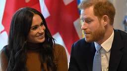 LONDON, UNITED KINGDOM - JANUARY 07: Prince Harry, Duke of Sussex and Meghan, Duchess of Sussex gesture during their visit to Canada House in thanks for the warm Canadian hospitality and support they received during their recent stay in Canada, on January 7, 2020 in London, England.