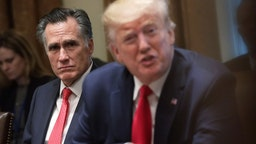 U.S. Sen. Mitt Romney (R-UT) listens as President Donald Trump speaks during a listening session on youth vaping of electronic cigarette on November 22, 2019 in the Cabinet Room of the White House in Washington, DC. President Trump met with business and concern group leaders to discuss on how to regulate vaping products and keep youth away from them. (Photo by Alex Wong/Getty Images)
