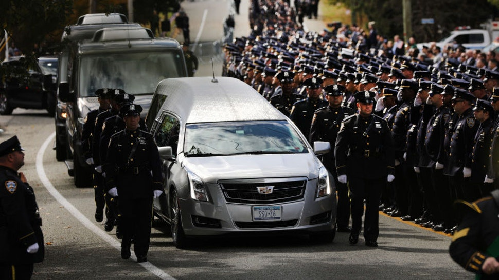 MONROE, NEW YORK - OCTOBER 04: The funeral procession of fallen NYPD Officer Brian Mulkeen departs the Church of the Sacred Heart on October 04, 2019 in Monroe, New York. Officer Mulkeen had been on the force for seven years and was killed while wrestling with an armed man during a confrontation in the Bronx. The shooting has been called a friendly fire incident.