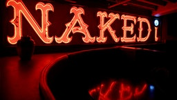 """BOSTON - JULY 21: The former Naked i strip club sign hangs in the lower level of West End Johnnie's in Boston. The Naked i was one of many venues in the former """"Combat Zone"""" adult entertainment district."""