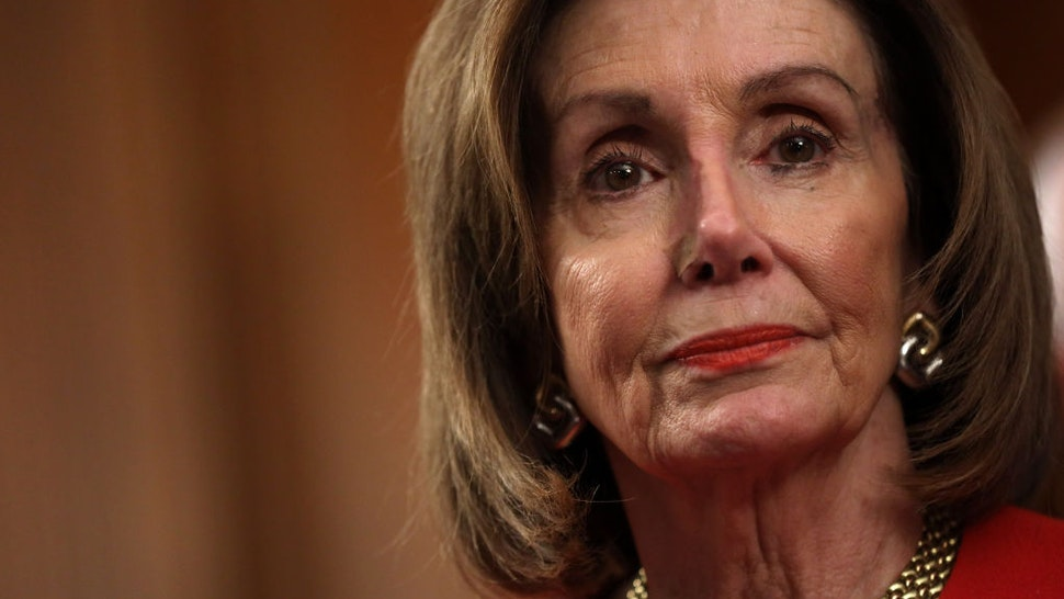 """U.S. Speaker of the House Rep. Nancy Pelosi (D-CA) listens during an event at the Rayburn Room of the U.S. Capitol December 19, 2019 in Washington, DC. House Democrats held an event celebrating the """"legislative progress the House Democratic Majority has made For The People in 2019."""" (Photo by Alex Wong/Getty Images)"""