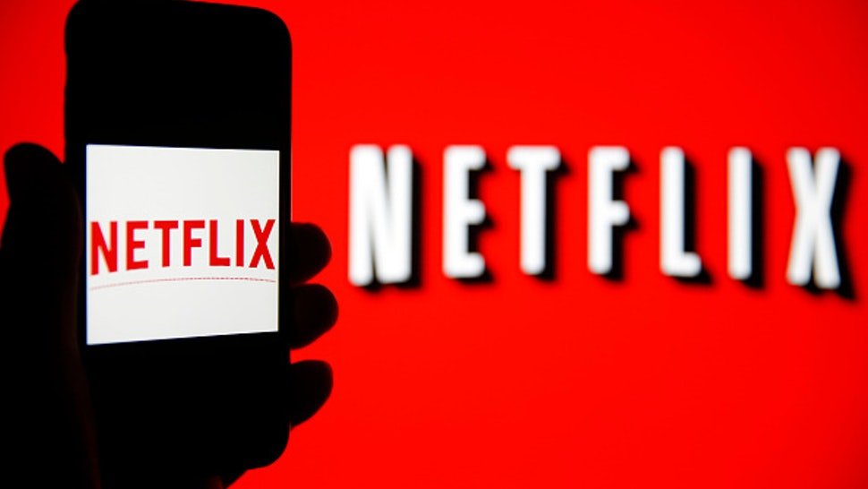 PARIS, FRANCE - FEBRUARY 13: In this photo iIllustration, the Netflix logo is seen on the screen of an iPhone in front of a computer screen showing a Netflix logo on February 13, 2019 in Paris, France. Netflix, the US giant of online video subscription, has more than 5 million subscribers in France, 4 and a half years after its arrival in France in September 2014, a spokesman for the company revealed on Wednesday. Netflix offers movies and TV series over the internet and now has 137 million subscribers worldwide.