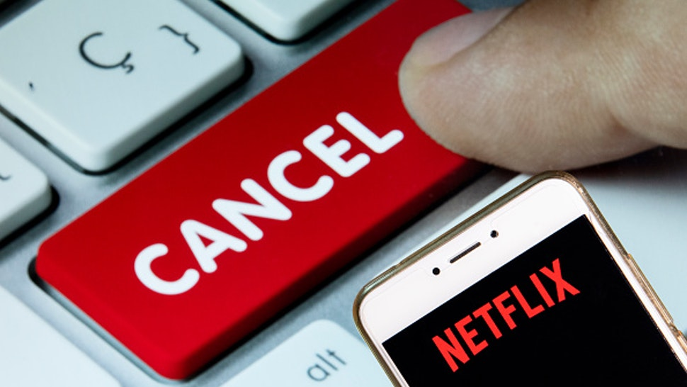 HONG KONG - 2018/12/02: In this photo illustration, the American global on-demand Internet streaming media provider Netflix logo is seen displayed on an Android mobile device with a computer key which says cancel.