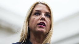 Pam Bondi, Florida attorney general, speaks during a press conference following a meeting with U.S. President Donald Trump, not pictured, on school safety at the White House in Washington, D.C., U.S., on Thursday, Feb. 22, 2018. Trumpcalled for paying bonuses to teachers who carry guns in the classroom, embracing a controversial proposal to curb school shootings hours after offering a full-throated endorsement of the National Rifle Association.