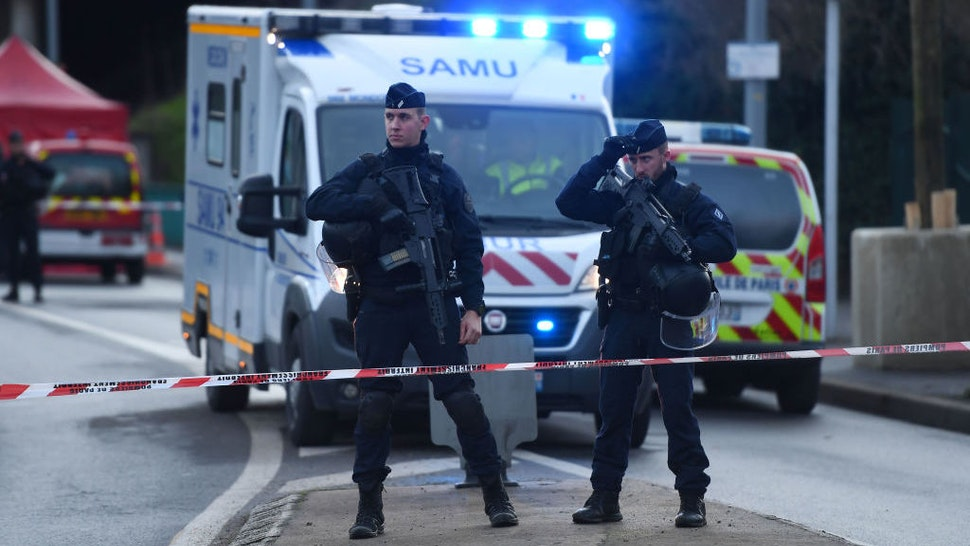 """Police officers stand guard on January 3, 2020 in L'Hay-les-Roses on the site where police shot dead a knife-wielding man who killed one person and injured at least two others in a nearby park of the south of Paris' suburban city of Villejuif. - The man had attacked """"several people"""" in a park in Villejuif before he was """"neutralised"""", the Paris police department said. Sources close to the investigation told AFP one of the victims had later died. The attacker was shot dead by police in a neighbouring suburb. The attacker's motive has not been made clear. (Photo by CHRISTOPHE ARCHAMBAULT / AFP) (Photo by CHRISTOPHE ARCHAMBAULT/AFP via Getty Images)"""