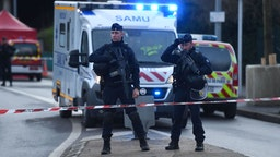 "Police officers stand guard on January 3, 2020 in L'Hay-les-Roses on the site where police shot dead a knife-wielding man who killed one person and injured at least two others in a nearby park of the south of Paris' suburban city of Villejuif. - The man had attacked ""several people"" in a park in Villejuif before he was ""neutralised"", the Paris police department said. Sources close to the investigation told AFP one of the victims had later died. The attacker was shot dead by police in a neighbouring suburb. The attacker's motive has not been made clear. (Photo by CHRISTOPHE ARCHAMBAULT / AFP) (Photo by CHRISTOPHE ARCHAMBAULT/AFP via Getty Images)"