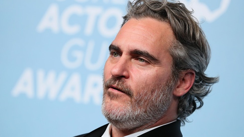 US actor Joaquin Phoenix poses with the trophy for Outstanding Performance by a Male Actor in a Leading Role in the press room during the 26th Annual Screen Actors Guild Awards at the Shrine Auditorium in Los Angeles on January 19, 2020.