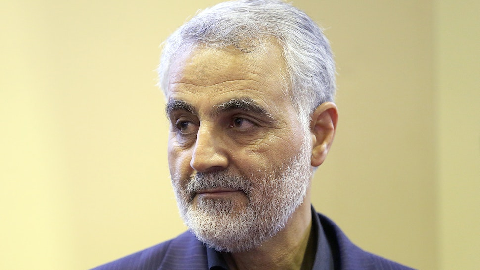 (FILES) In this picture taken on September 14, 2013, the commander of the Iranian Revolutionary Guard's Quds Force, Gen. Qassem Soleimani, is seen as people pay their condolences following the death of his mother in Tehran. For a man widely reported to be playing a key role in helping Iraq's routed military recover lost ground, Qassem Soleimani, 57, the commander of Iran's feared Quds Force, remains invisible.