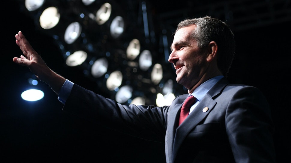 Democratic Gubernatorial Candidate Ralph Northam waves as he arrives to speak during a campaign rally in Richmond, Virginia on October 19, 2017.
