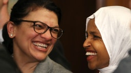 Rep. Ilhan Omar (D-MN) (R) and Rep. Rashida Tlaib (D-MN) attend a news conference where House and Senate Democrats introduced the Equality Act of 2019 which would ban discrimination against lesbian, gay, bisexual and transgender people, on March 13, 2019 in Washington, DC.