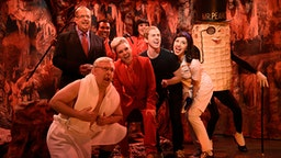 """SATURDAY NIGHT LIVE -- """"Adam Driver"""" Episode 1778 -- Pictured: (l-r) Jon Lovitz as Alan Dershowitz, Chris Redd as a demon, Beck Bennett as Mitch McConnell, Kate McKinnon as the Devil, Chloe Fineman as a demon, Alex Moffat as Mark Zuckerberg, Heidi Gardner as Flo, and Mikey Day as Mr. Peanut during the """"Dershowitz Argues for Trump"""" Cold Open on Saturday, January 25, 2020 --"""