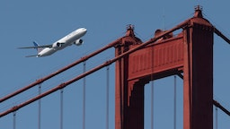 A United Airlines Boeing 777-300ER flies over the Golden Gate Bridge during Fleet Week 2019 in San Francisco, California on October 11, 2019. United Airlines will hold a conference call to discuss third-quarter 2019 financial results on Wednesday, October 16. (Photo by Yichuan Cao/NurPhoto)