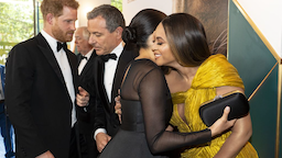 Britain's Prince Harry, Duke of Sussex (L) chats with Disney CEO Robert Iger as Britain's Meghan, Duchess of Sussex (2nd R) embraces US singer-songwriter Beyoncé (R) as they attend the European premiere of the film The Lion King in London on July 14, 2019.
