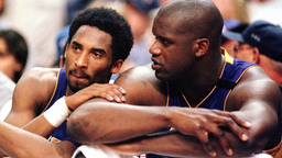 Los Angeles Lakers forward Kobe Bryant (L) speaks with teammate Shaquille O'Neal as they sit out the end of the fourth quarter against the Phoenix Suns in game four of the Western Conference semi-finals 14 May 2000 at America West Arena in Phoenix.