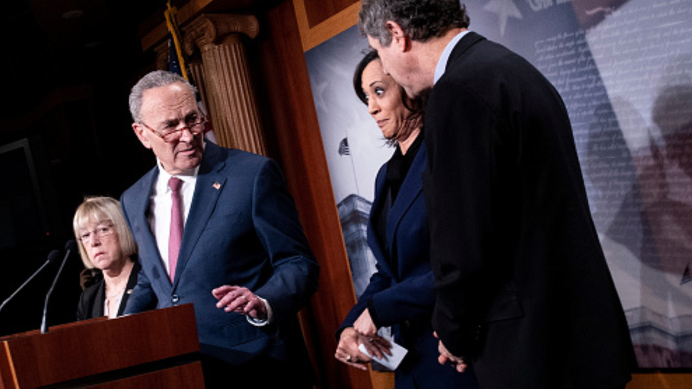 Senator Patty Murray (D-WA) listens while Senate Minority Leader Charles E. Schumer (D-NY) shushes Senator Kamala Harris (D-CA) and Senator Sherrod Brown (D-OH) during a press conference during the impeachment trial of US President Donald Trump on Capitol Hill January 31, 2020, in Washington, DC. - The US Senate could acquit Donald Trump of impeachment charges as early as January 31, 2020 after Democratic efforts to call trial witnesses appeared to fall short, handing the president a decisive political victory heading into a tough re-election fight.