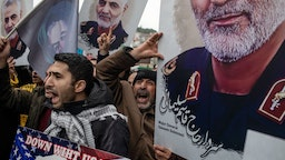 People hold posters showing the portrait of Iranian Revolutionary Guard Major General Qassem Soleimani and chant slogans during a protest outside the U.S. Consulate on January 05, 2020 in Istanbul, Turkey. Major General Qassem Soleimani, was killed by a U.S. drone strike outside the Baghdad Airport on January 3. Since the incident, tensions have risen across the Middle East. (Photo by Chris McGrath/Getty Images)