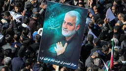 """Iranian mourners gather during the final stage of funeral processions for slain top general Qasem Soleimani, in his hometown Kerman on January 7, 2020. - Soleimani was killed outside Baghdad airport on January 3 in a drone strike ordered by US President Donald Trump, ratcheting up tensions with arch-enemy Iran which has vowed """"severe revenge"""". The assassination of the 62-year-old heightened international concern about a new war in the volatile, oil-rich Middle East and rattled financial markets."""