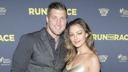 """Tim Tebow and Demi-Leigh Nel-Peters attend the premiere of Roadside Attractions' """"Run The Race"""" at the Egyptian Theatre on February 11, 2019 in Hollywood, California. (Photo by Michael Tullberg/Getty Images)"""