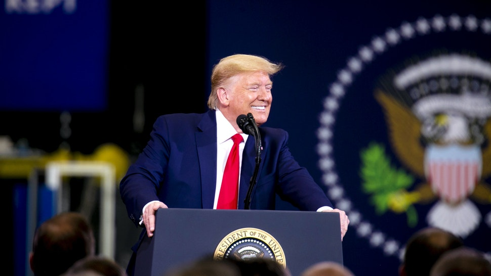 U.S. President Donald Trump smiles while speaking during a visit to a Dana Inc. manufacturing facility in Warren, Michigan, U.S., on Thursday, Jan. 30, 2020. Trump is traveling Thursday to Michigan and Iowa -- where he's expected to tout the new U.S.-Mexico-Canada Agreement (USMCA) trade pact just as Democrats try to win over voters in next weeks Iowa caucuses.