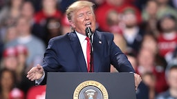 BATTLE CREEK, MICHIGAN - DECEMBER 18: President Donald Trump addresses his impeachment after learning how the vote in the House was divided during a Merry Christmas Rally at the Kellogg Arena on December 18, 2019 in Battle Creek, Michigan. While Trump spoke at the rally the House of Representatives voted, mostly along party lines, to impeach the president for abuse of power and obstruction of Congress, making him just the third president in U.S. history to be impeached.