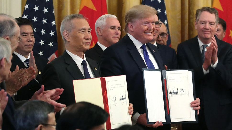 WASHINGTON, DC - JANUARY 15: U.S. President Donald Trump and Chinese Vice Premier Liu He, hold up signed agreements of phase 1 of a trade deal between the U.S. and China, in the East Room at the White House, on January 15, 2020 in Washington, DC. Phase 1 is expected to cut tariffs and promote Chinese purchases of U.S. farm, and manufactured goods while addressing disputes over intellectual property.