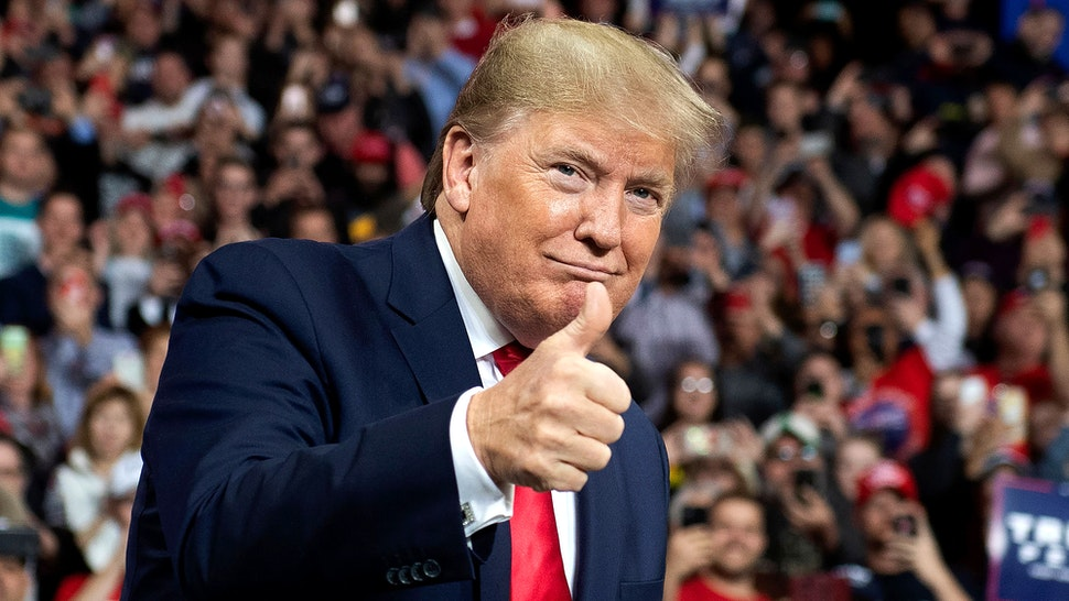 """US President Donald Trump arrives for a """"Keep America Great"""" campaign rally at Huntington Center in Toledo, Ohio, on January 9, 2020."""