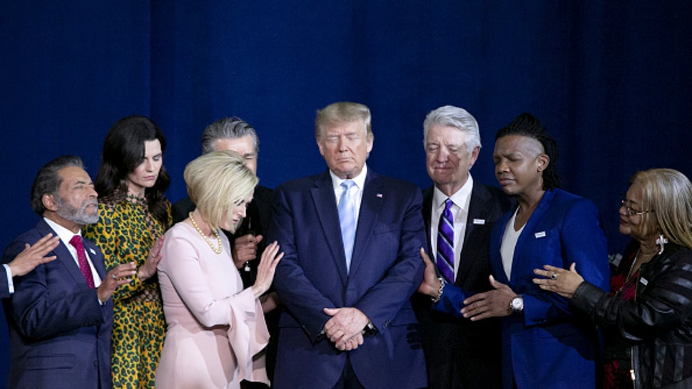 FILE: U.S. President Donald Trump, center, prays during an 'Evangelicals for Trump' Coalition launch event in Miami, Florida, U.S., on Friday, Jan. 3, 2020. Monday, January 20, 2020, marks the third anniversary of U.S. President Donald Trump's inauguration. Our editors select the best archive images looking back over Trumps term in office.